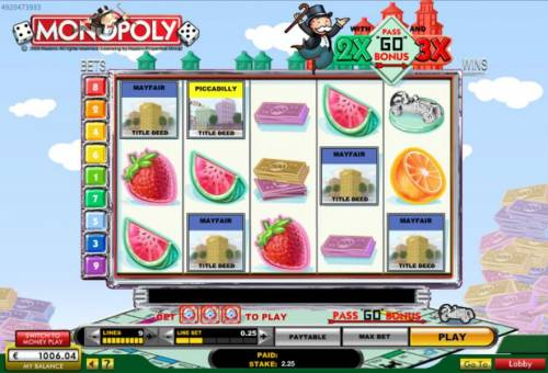 Monopoly with Pass Go Bonus Big Bonus Slots Main game board featuring five reels and 9 paylines with a $10,000 max payout