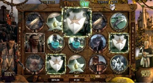 Orc vs Elf Big Bonus Slots three shield symbols triggers the woodland spin feature